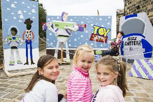 From the left, Daisy Didgiunaitis, 10, Charlotte Stanger, two, and Holly Stanger at an amazing Toy Story display.