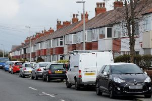 MPs are calling of a nationwide ban on cars parking on pavements