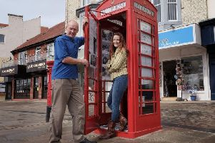 Sarah Normandale and Mark Vesey of Scarborough Maritime Heritage Centre unveil the new history box on Sandside.