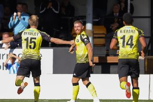 George Thomson is all smiles after firing Harrogate Town into a first-half lead against Sutton United. Picture: Matt Kirkham