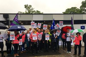 Grove staff and supporters during strike action earlier this year.