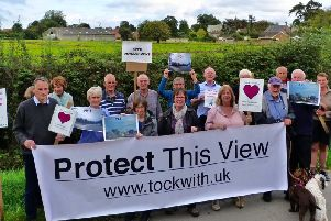 Members of the Tockwith Residents' Association protest at the proposed site of the development.