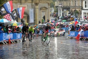 Spectators watch the mens elite road in heavy rain in Harrogate on day 9 of the UCI 2019 Cycling Road World Championship from Leeds to Harrogate . Picture Tony Johnson