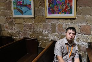 Henshaws art maker Jacob Pulham close up with some of his artwork in Knaresborough.