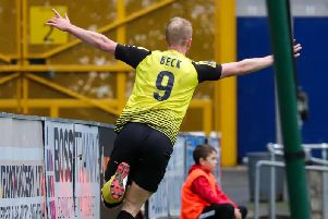 Harrogate Town striker Mark Beck celebrates the second of his two goals against FC Halifax Town during Saturday's FA Cup fourth qualifying round clash. Picture: Matt Kirkham