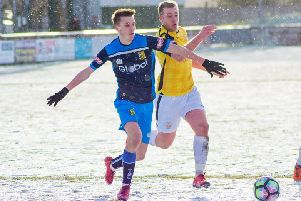 Tadcaster Albion 's Casey Stewart in action in the snow at Trafford. Picture: Matthew Apppleby