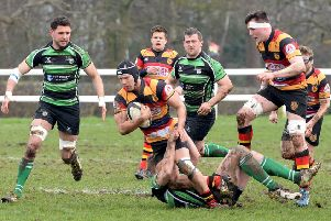 Keane Naylor is tackled during Harrogate RUFC's narrow home loss to Lymm. Picture: Richard Bown