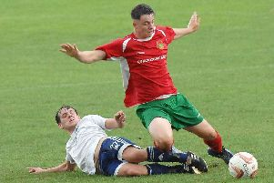 Harrogate Railway forward Sean Hunter is felled during Saturday's pre-season friendly with Leeds City. Picture: Adrian Murray