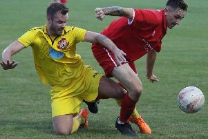 Knaresborough Town's Steve Bromley is dispossessed during Tuesday's defeat at Bridlington Town. Picture: Craig Dinsdale