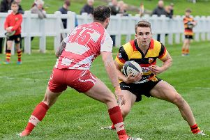 Harry Barnard looks for a way to the Wirral try-line. Picture: Richard Bown
