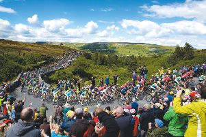 The peloton makes it's way up Grinton Moor on day 1 of Le Tour de France, just as it will do against next year's 2019 UCI World Championships in Yorkshire. (Picture: Shaun Flannery/SWPix.com)
