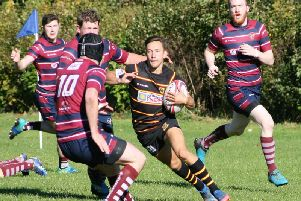 Harrogate Pythons ace Ned Rutty runs at the Aireborough defence on his way to the try-line
