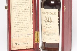 One bottle of Bowmore 30th Anniversary Islay Single Malt, distilled 1963, sold for �2,800.