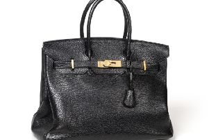 This Herm�s Black Leather Birkin Bag realised �5,000 at Tennants Auctioneers' sale of Costume, Accessories and Textiles.