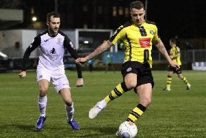 Harrogate Town's Joe Leesley in action against Stockport County during last season's clash at the CNG Stadium. Picture: Matt Kirkham