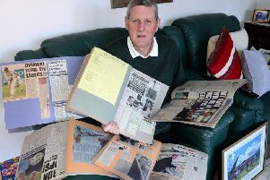 Michael Gough senior with scrapbook of memories devoted to cricketing umpire son Michael.