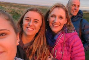 Laura (second from right) with her family.