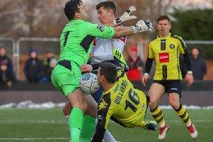 Aaron Williams is thwarted by Stockport County goalkeeper Ben Hinchliffe. Picture: Matt Kirkham
