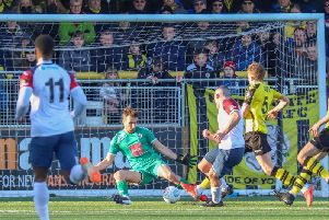 Harrogate Town goalkeeper James Belshaw is beaten by Frank Mulhern during Saturday's FA Trophy loss to Stockport County. Picture: Matt Kirkham