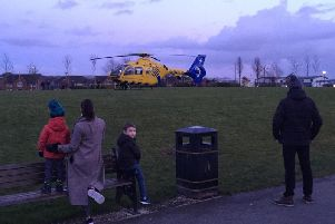 Residents watch on as an air ambulance landed in Buckshaw Village