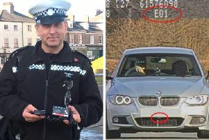 Investigating officer TC Forth and the BMW in question.