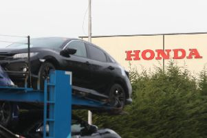 A car transporter at the Honda plant in Swindon, which the company is planning to close with the loss of more than 3,000 jobs. Pic: Steve Parsons/PA Wire.