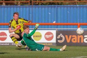Mark Beck slots home Harrogate Town's second goal at Braintree Town. Picture: Matt Kirkham