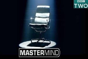 Here's your chance to sit in the iconic black leather chair