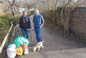 Belinda John and her partner Kevin Little during one of her litter picks