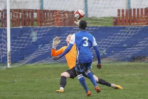 Frickley Athletic debutant Ousman Cham calmy lobs the Ossett United goalkeeper to score. Picture: Onion Bag Photos