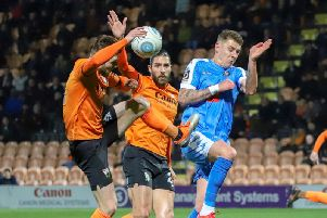 Harrogate Town's Joe Leesley battles for possession with two Barnet defenders. Picture: Matt Kirkham
