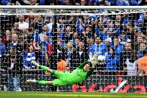 Craig MacGillivray makes the crucial penalty save in the Checkatrade Trophy final