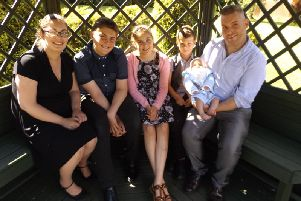 Hannah Buxton with family members Owen, Evie, Harry, Austin and David.