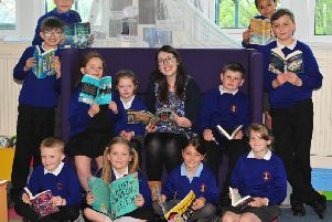 Georgia Duffy of Imagined Things Bookshop with children taking part in her reading books scheme at New Park Primary Academy in Harrogate. (Picture by Gerard Binks)