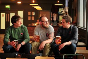 In the new tap room at Roosters' new Hornbeam Park premises - Roosters head brewer Oliver Fozard, taproom manager Josh Molloy and Roosters commercial manager Tom Fozard. (Picture by Gerard Binks)