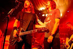 It's times like these: The UK Foo Fighters Jay Apperley, right, on stage with the real Dave Grohl.