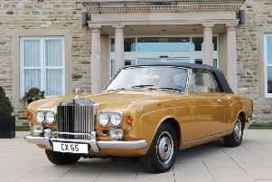 A 1972 gold Rolls Royce Corniche II. This realised �51,000 at auction.