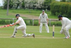 Birstwith captain Jon Millward hits out on his way to a big score with Goldsborough wicket-keeper Jon Jackson looking on. Picture: Gerard Binks