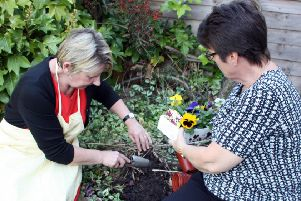 Hub Clubs enjoy looking after the garden at George Armitage House.