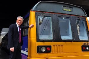 Harrogate and Knaresboroughs MP Andrew Jones with a dreaded Pacer train.