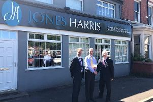 Martin Wigley and Stewart Case of Jones Harris with Fleetwood Trust'Chairman, Lord Tom McNally. The accountancy firm have donated 1,000 to the Trust's windows appeal.
