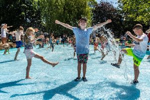 Lucy Bowman, 7, with her brother Alfie Bowman, 11, and friend Jack Simpson, 10, cooling down in the paddling pool in Valley Gardens as the heatwave hits Harrogate.