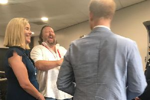 Clair Challenor-Chadwick, managing director of Cause UK; shares a joke with superstar songwriter Eliot Kennedy; Emma Willis MBE, founder of the charity, Style for Soldiers, and Prince Harry with his back to camera.