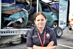 Lancashire Fire Service Prevention Support Officer Clare Burscough with the wrecked car on display that Dan Birch was killed in'The Alive to Drive Driving Safety Campaign held by Chorley Advanced Motorists outside Leyland Tescos