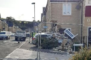 This image of the car that collided with the corner of a house was captured by Michelle Schofield-Cook in Burnley yesterday.