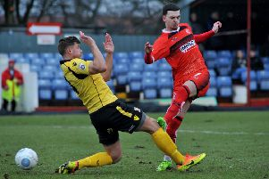 Ryan Jennings, pictured here in the red of Alfreton Town, has signed for Buxton FC