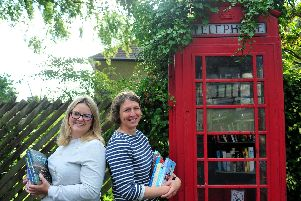 Pictured from left local residents, Holly Jones and Jane Kennerley, who want to save the phone box.