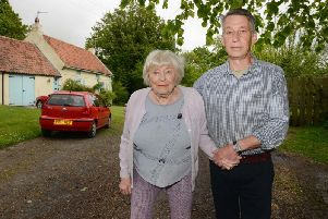 Thelma Peppert and John Proudlock outside Rose Cottage