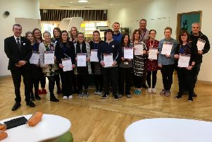 Hartlepool MP Mike Hill (far left) presented Jesmond Gardens Primary School support staff with Unison Stars in Our Schools certificates
