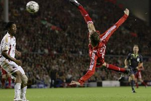 LIVERPOOL, UNITED KINGDOM - SEPTEMBER 27:  Peter Crouch (R) of Liverpool scores his team's third goal during the UEFA Champions League group C match between Liverpool and Galatasaray at Anfield on September 27, 2006 in Liverpool, England.  (Photo by Alex Livesey/Getty Images)